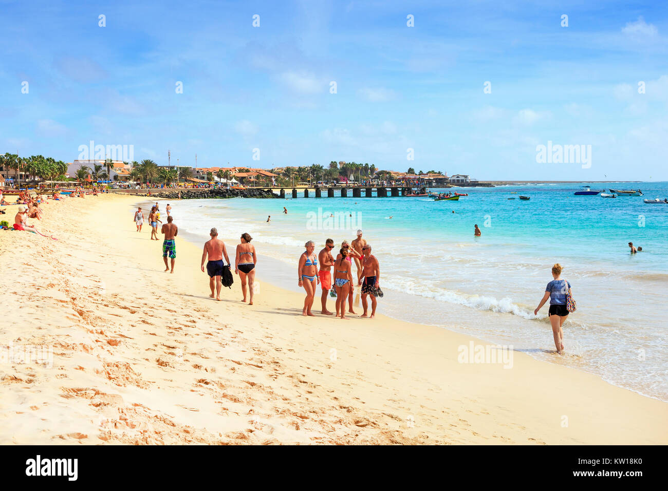Tourists and holidaymakers on the public beach at Santa Maria, Cape Verde, Africa - Stock Image