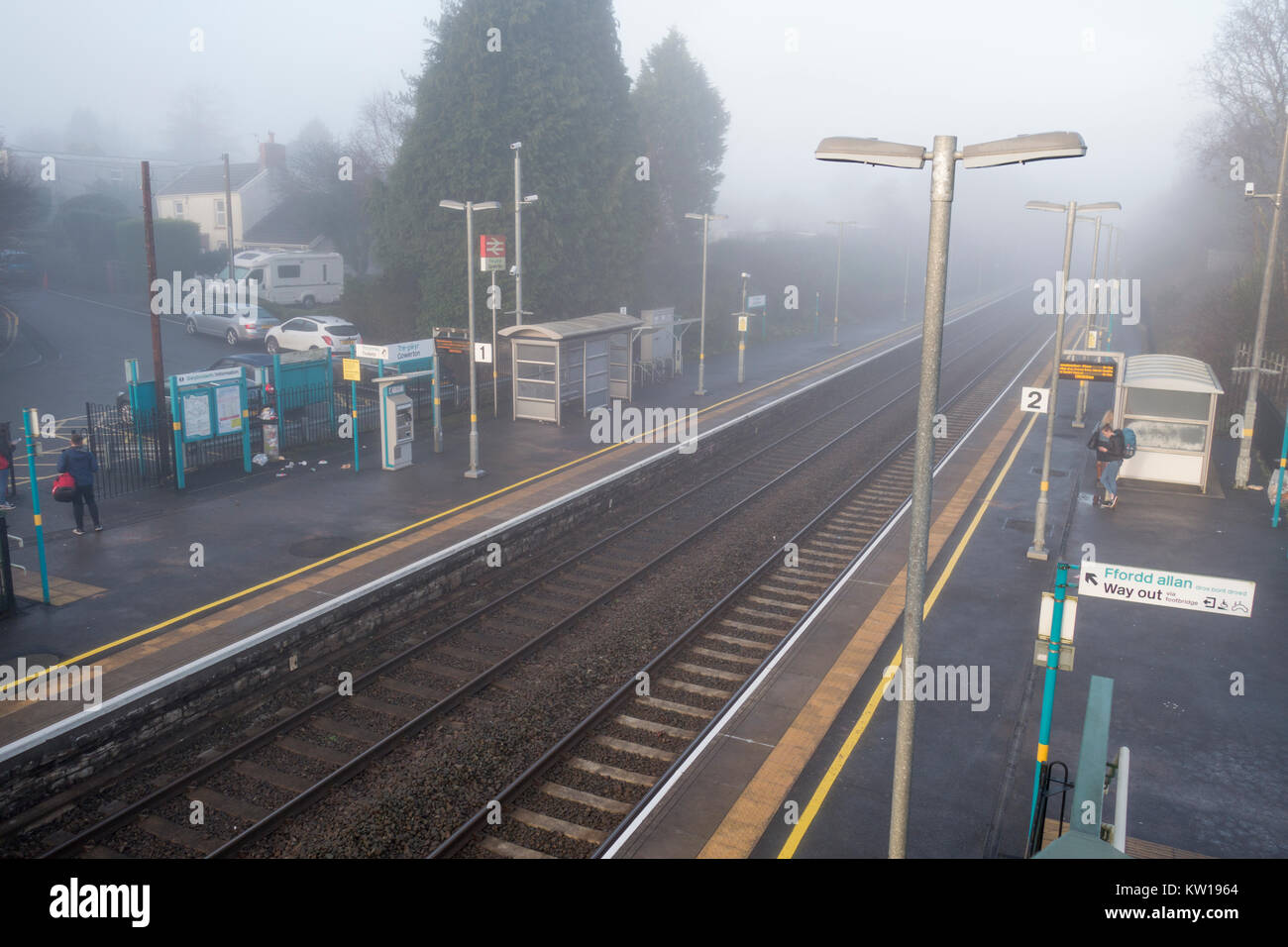 Gowerton train station on a misty morning. - Stock Image