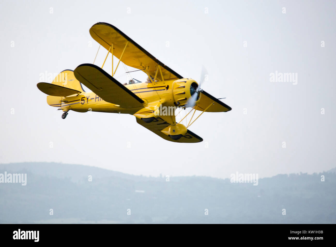 A 1930's Waco biplane flying at dawn over Laikipia, very close view banking away,Lewa Wilderness, Lewa Conservancy, - Stock Image