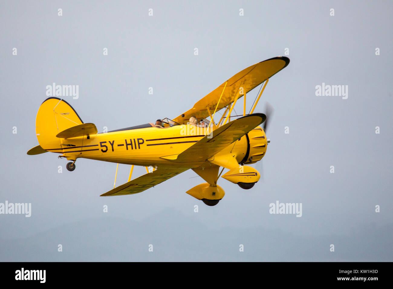A 1930's Waco biplane flying at dawn over Laikipia, very close view,  Lewa Wilderness,Lewa Conservancy, Kenya, - Stock Image