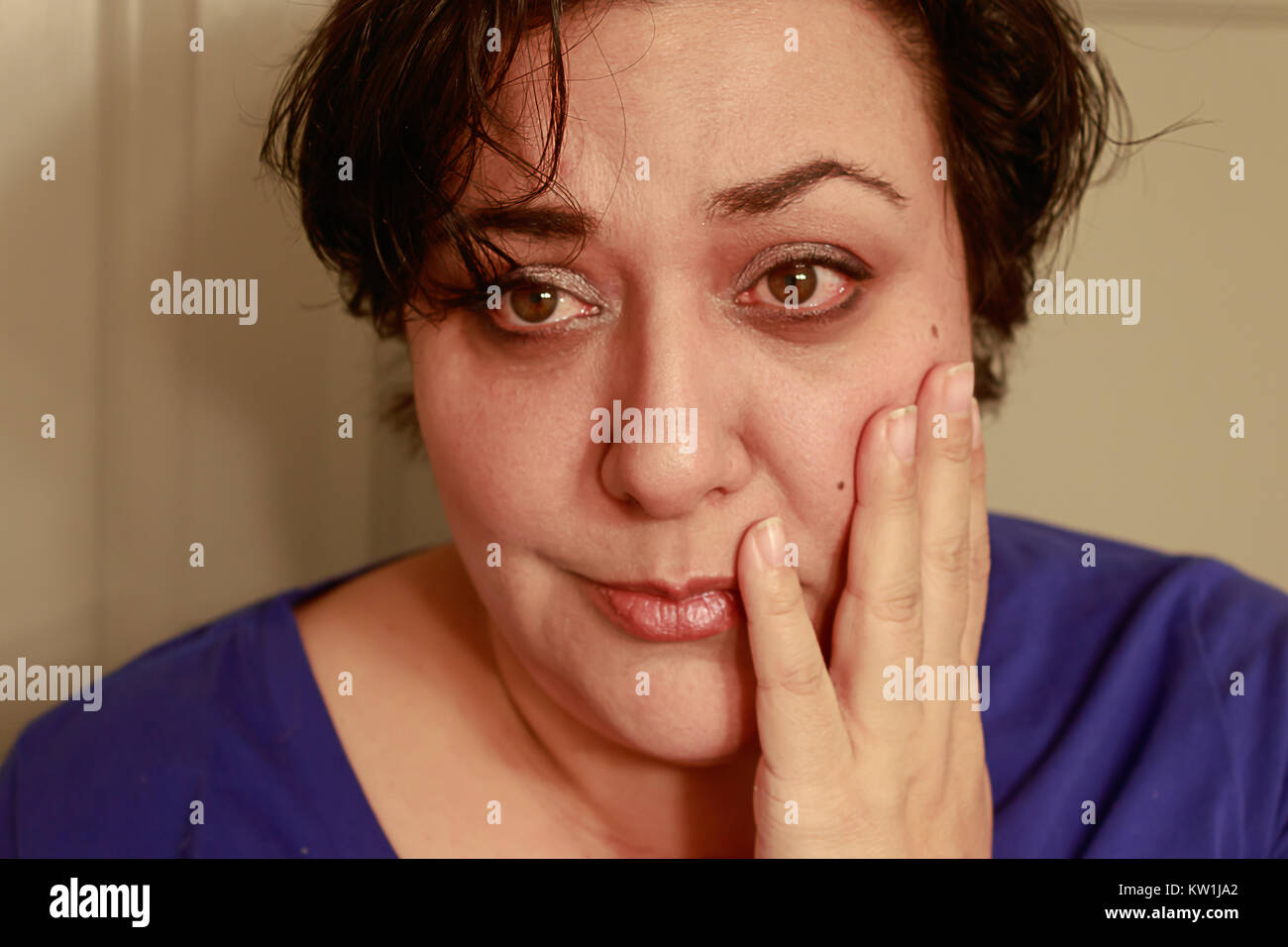 worried woman with short hair - Stock Image