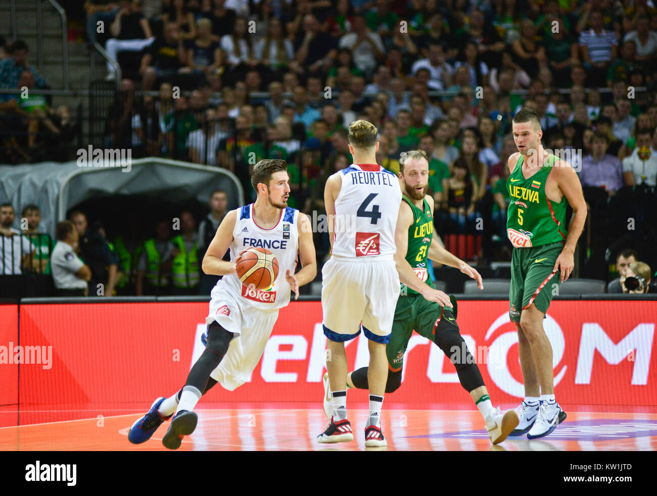 Nando de Colo playing pick and roll offense with teammate Thomas Heurtel (France) against Lithuania - Stock Image