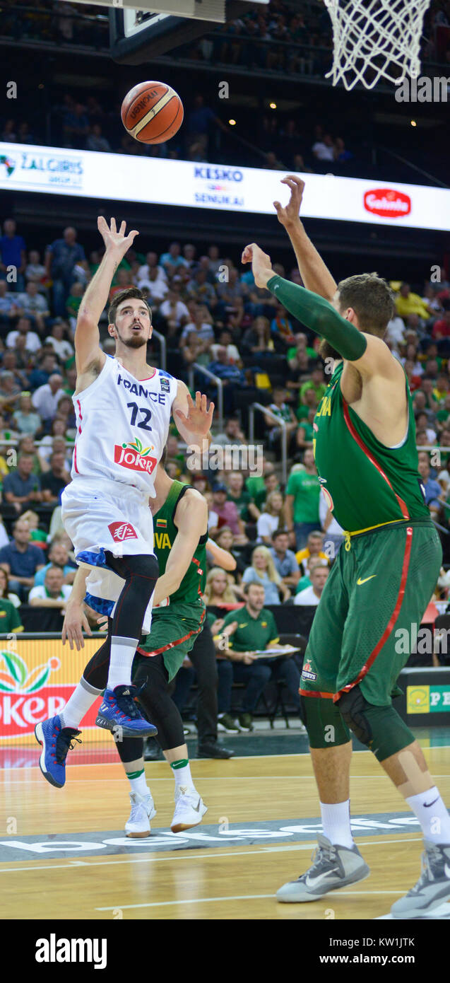 Nando De Colo (France) scoring against Jonas Valanciunas (Lithuania) - Stock Image