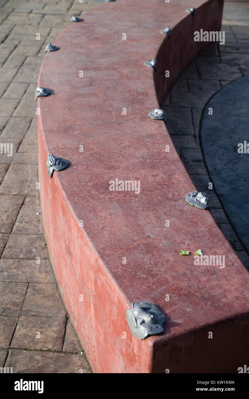 Concrete wall or bench with anti-skate deterrent devices installed - Stock Image