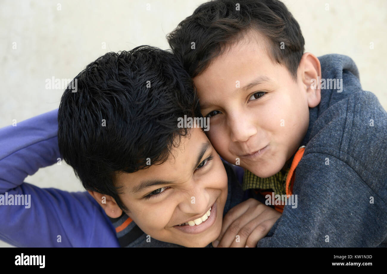 Two angry brothers fighting eachother - Stock Image
