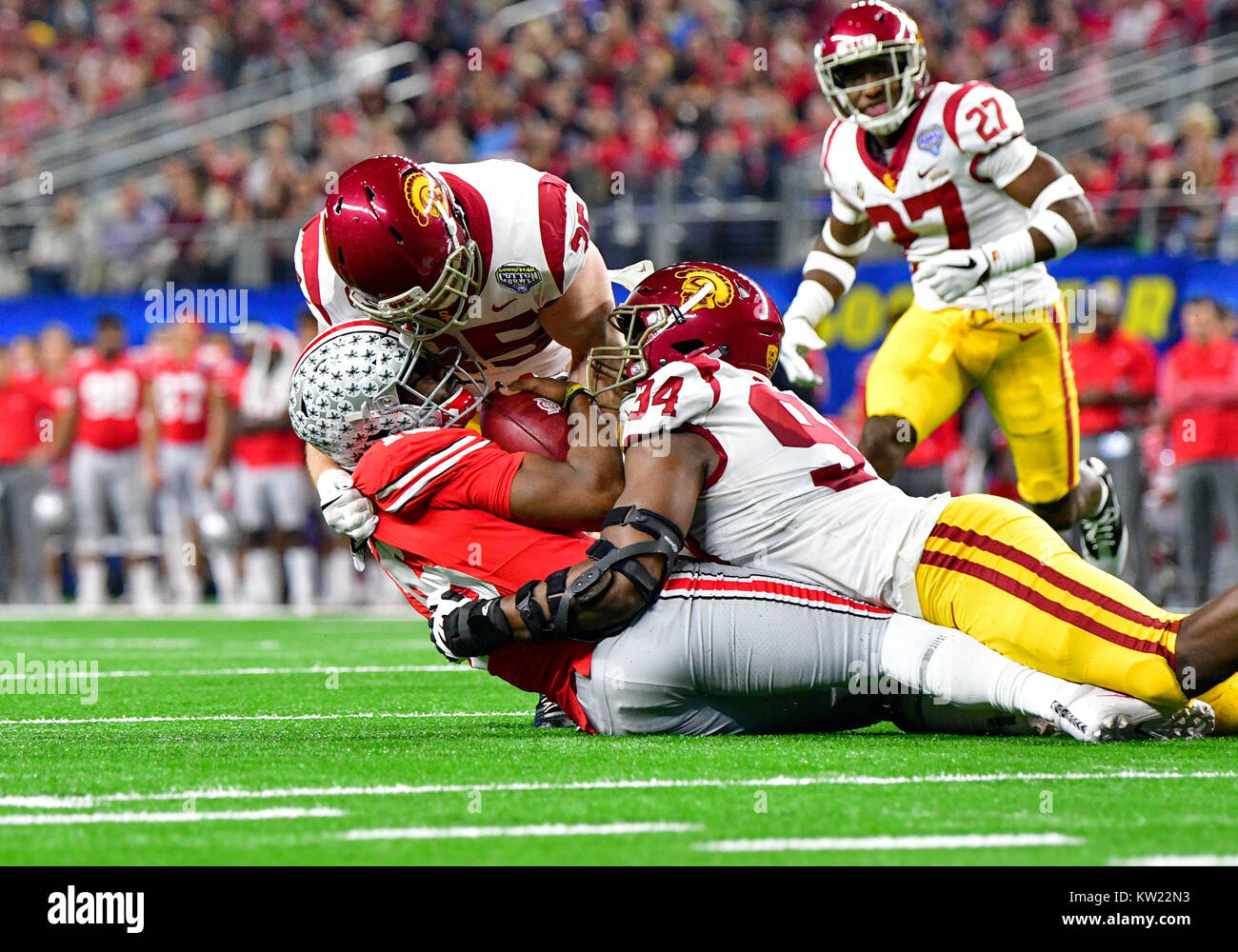 Arlington, Texas, USA. 29th December, 2017. Ohio State Buckeyes quarterback J.T. Barrett (16) is sacked by USC Trojans - Stock Image