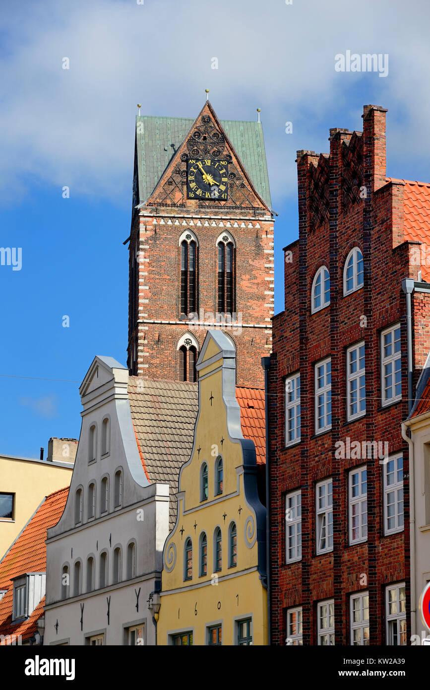 Wismar, gable in the L?bsche street and steeple Saint Marien, Giebel in der Lübsche Strasse und Kirchturm Sankt - Stock Image