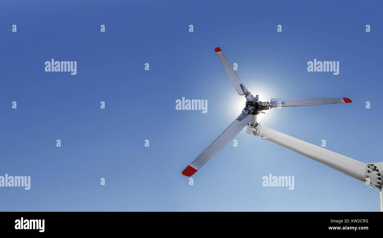 Closeup of helicopter tail rotor blade mechanism against blue sky - Stock Image