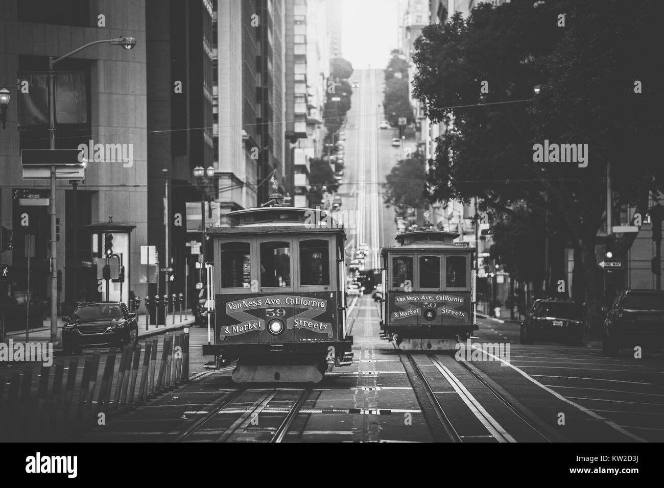 Classic view of historic traditional Cable Cars riding on famous California Street in beautiful morning light at - Stock Image