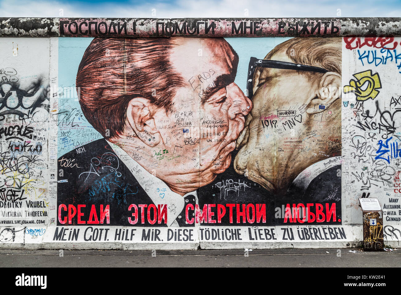 BERLIN, GERMANY - JULY 12: Street art graffiti painting 'The Kiss' by Dmitri Vrubel at famous East Side - Stock Image