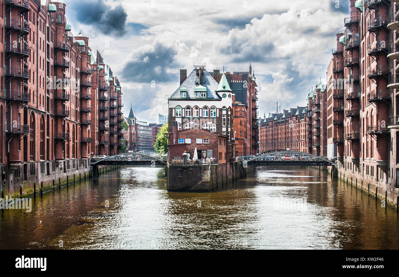 Beautiful view of famous Speicherstadt warehouse district with dark clouds before the storm in Hamburg, Germany Stock Photo