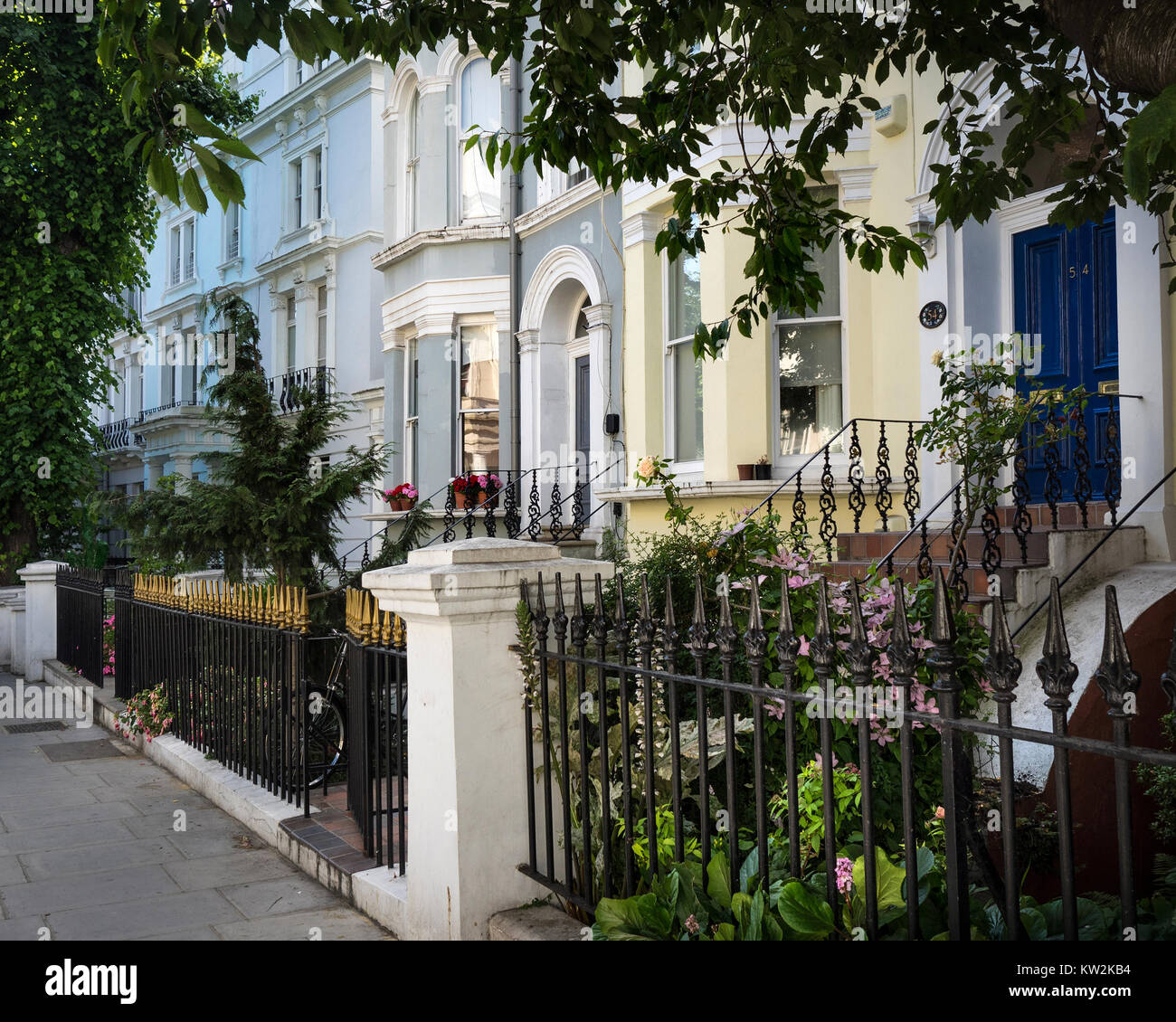 coloured houses on Elgin Crescent, Notting Hill in London in summer Stock Photo