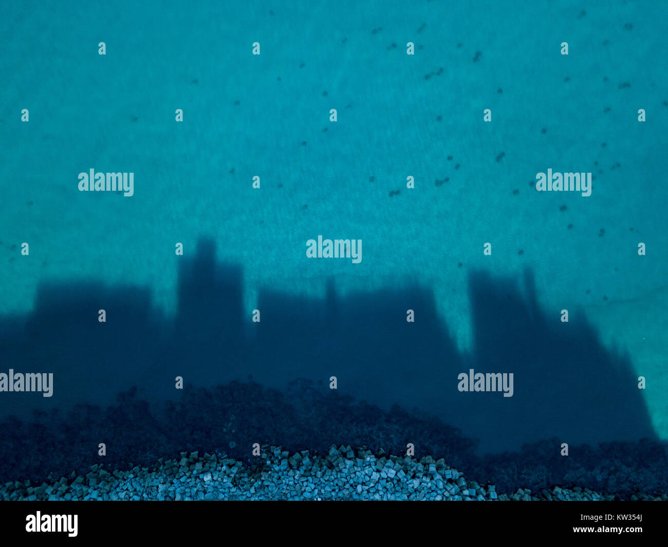 Aerial view of Pizzo Calabro, shadows of the buildings projecting onto the sea, silhouettes of houses projected - Stock Image