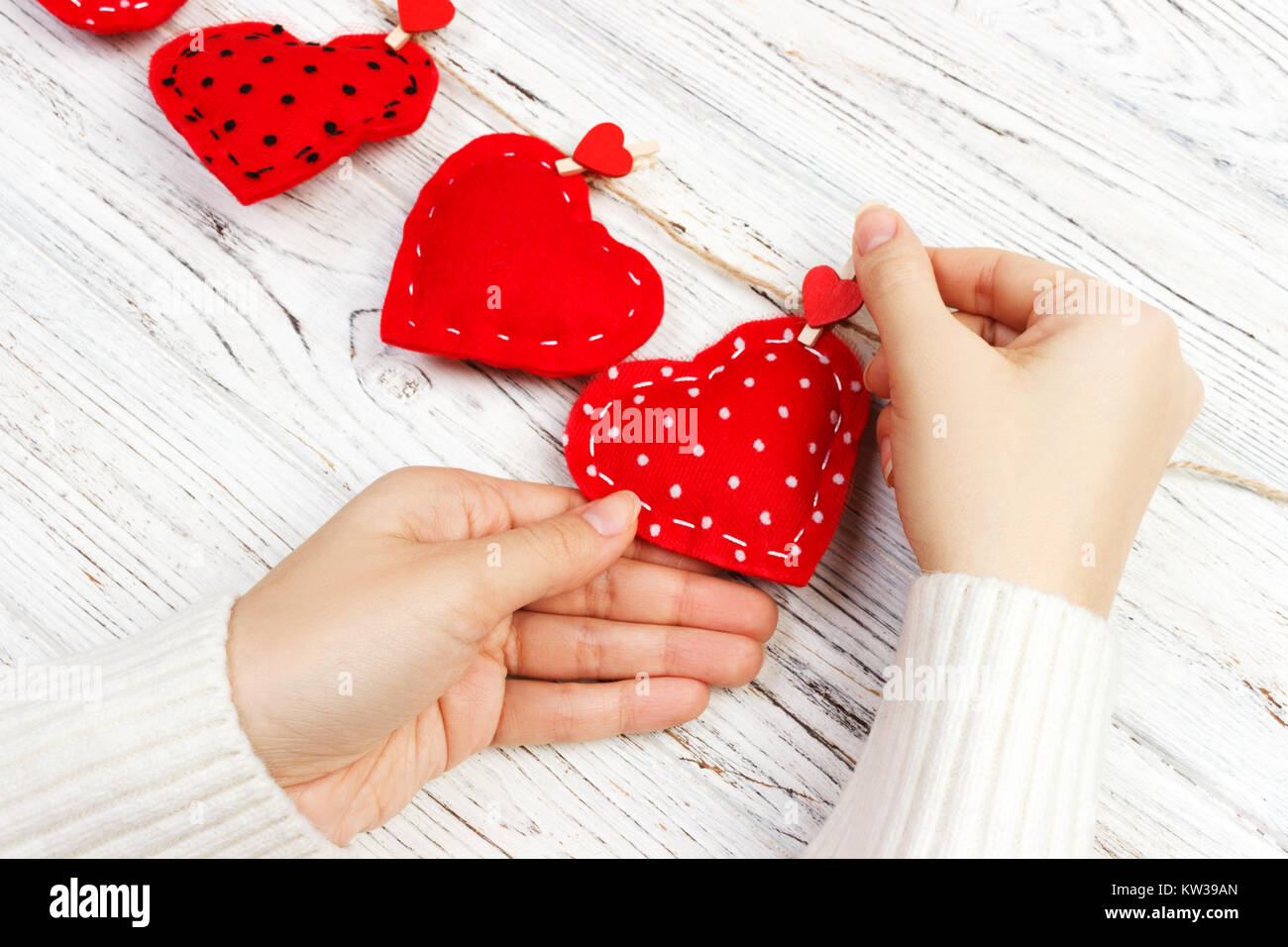 Valentine Background With Sewed Pillow Diy Handmade Hearts In Womans Hands At Rustic Wood Planks Happy Lovers Day Copy Space