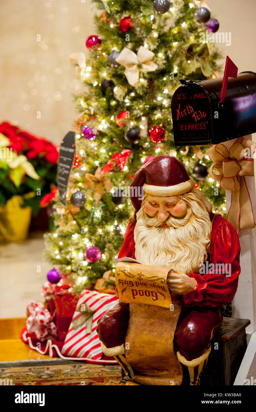 holidays christmas a santa claus figure is reading a list of boys and girls naughty or