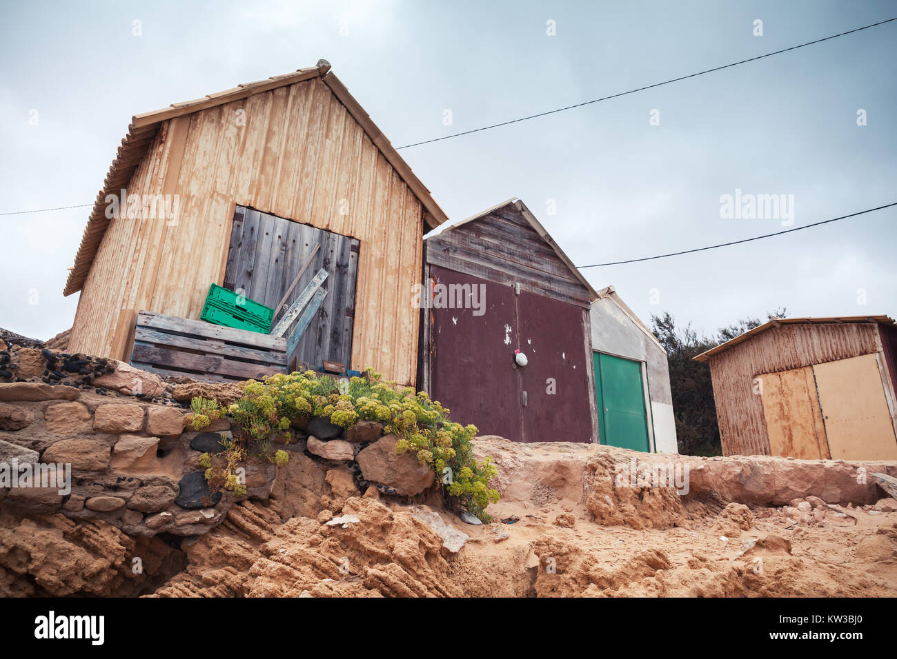 Wooden barns on the beach of Porto Santo island in the Madeira archipelago, Portugal - Stock Image