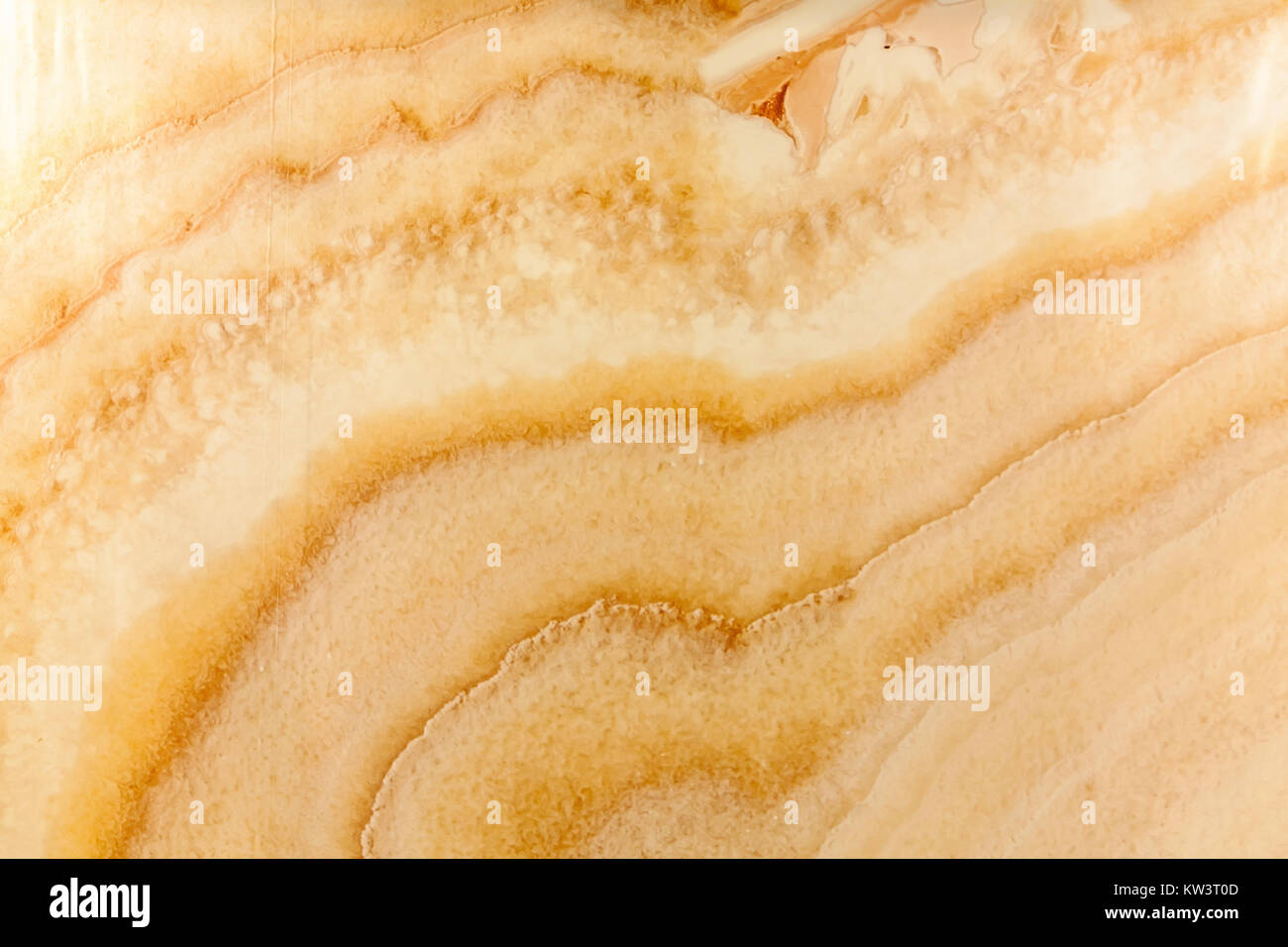 abstract texture of a surface of a natural stone of a yellowish shade, with interesting divorces and maculae. abstract - Stock Image