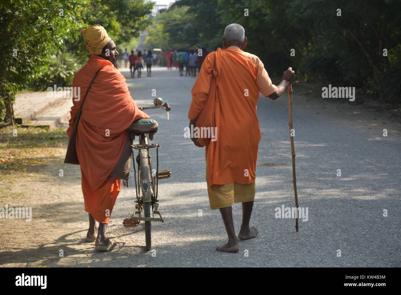 Two Elderly Monks walking on the street - Stock Image