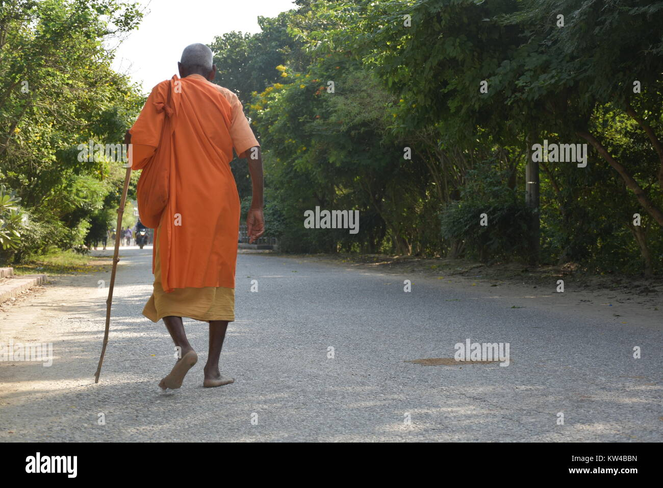 A monk walking on the street of Lumbini, the birthplace of Lord Buddha. - Stock Image