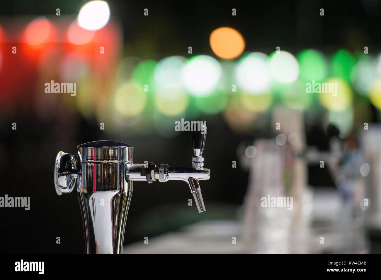 Dispenser for draft beer in a bar during beer fest - Stock Image