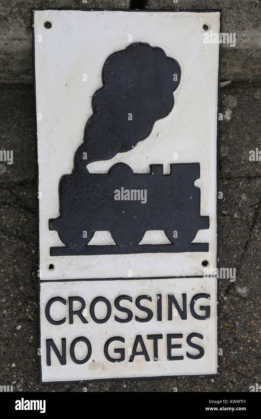 road sign declaring no gates at railway crossing, ireland - Stock Image