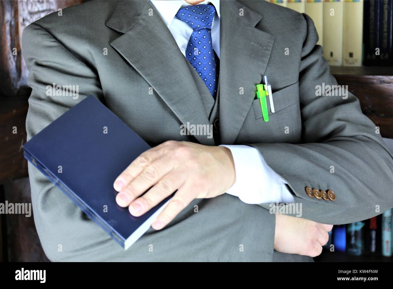 An concept Image of a Manager in a library - Stock Image
