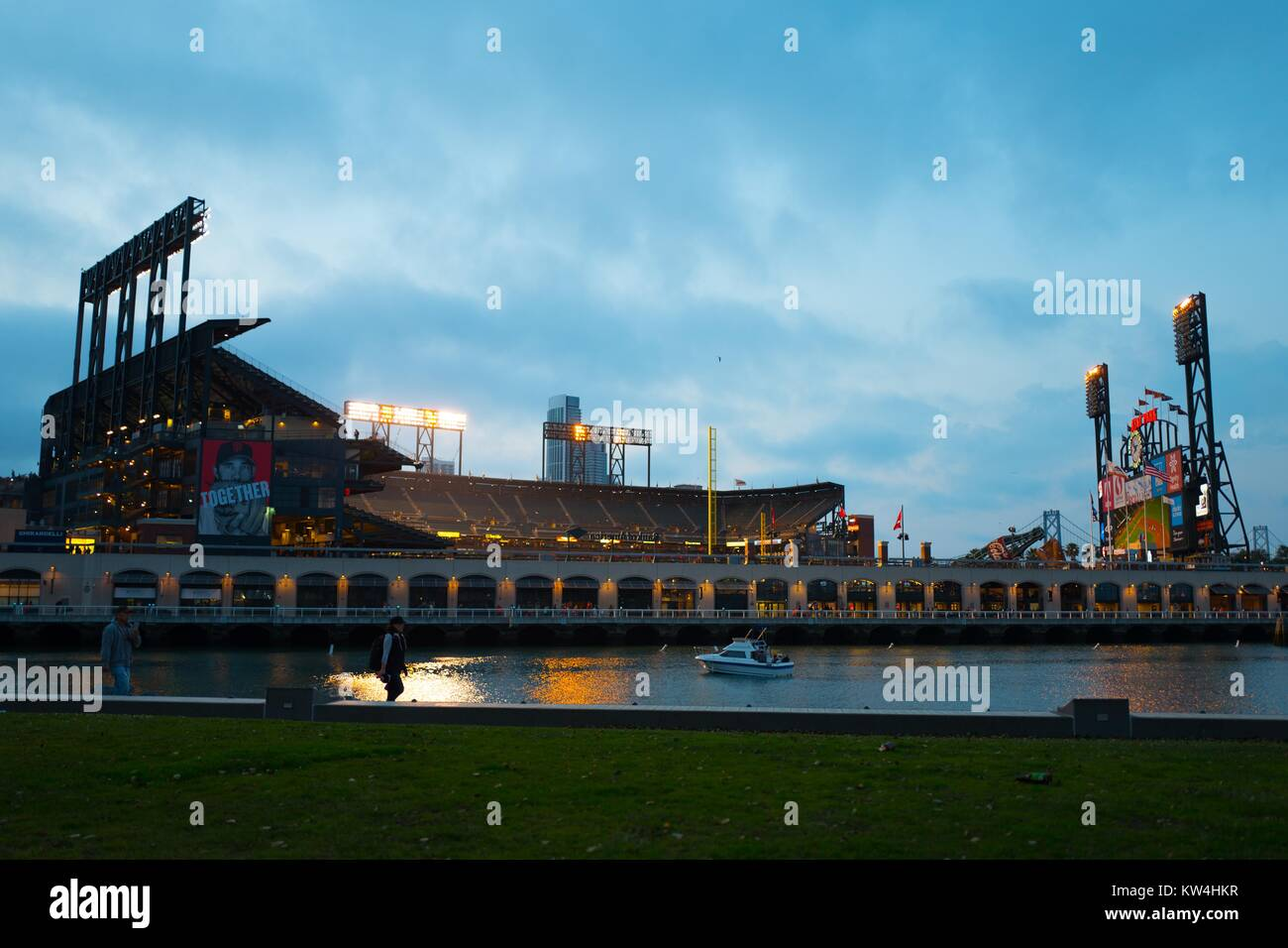 ATT Park, home of the San Francisco Giants baseball team, illuminated at night after a home game, viewed from China - Stock Image