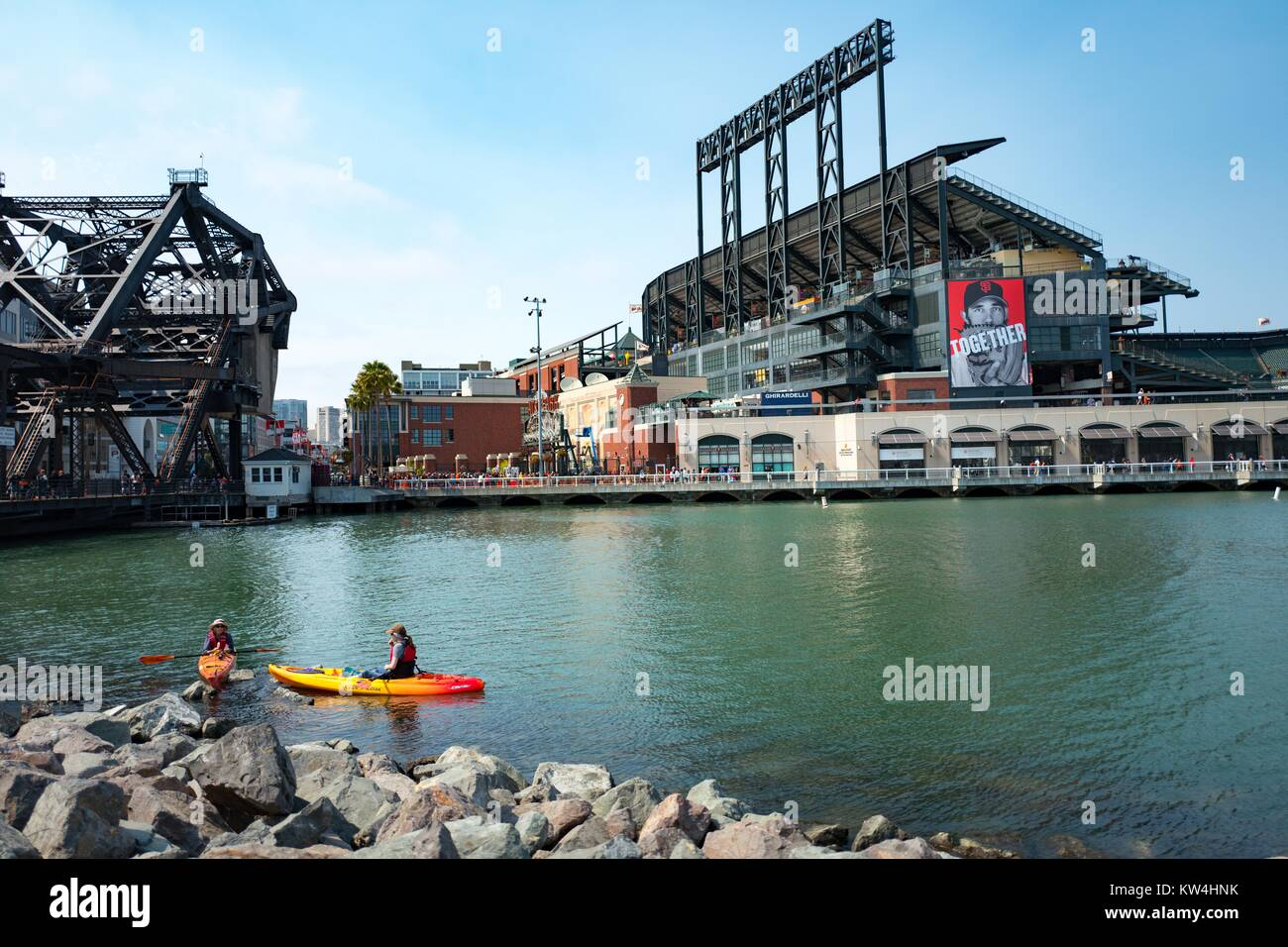 Two kaykers paddle through McCovey Cove near ATT Park, the baseball stadium of the San Francisco Giants, in the - Stock Image