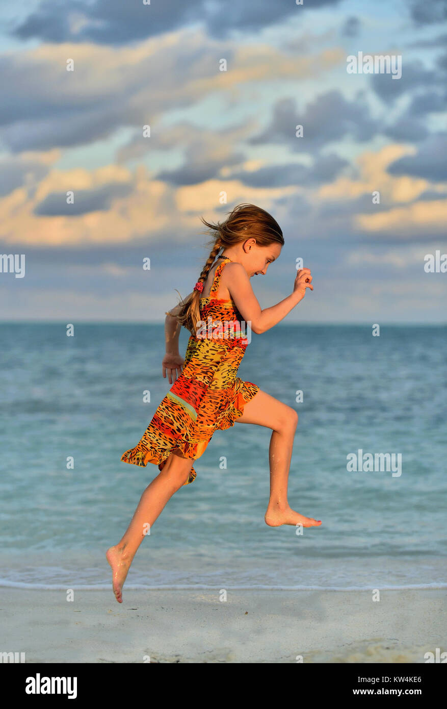 Cute Little Girl Running On Beach In Sunset Light Cuba