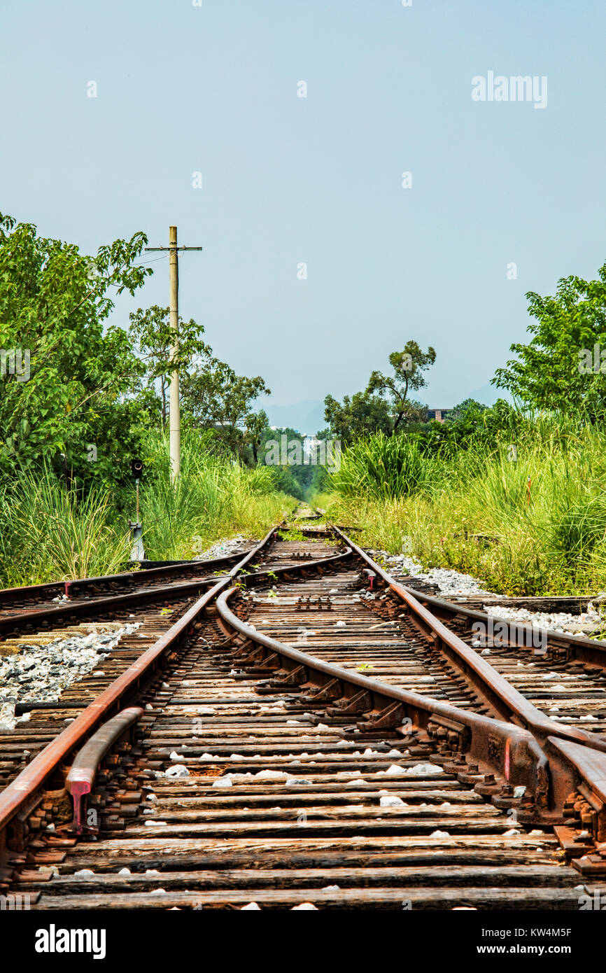 Old abandoned railway tracks out in the countryside of Guilin, Guangxi Province, China - Stock Image