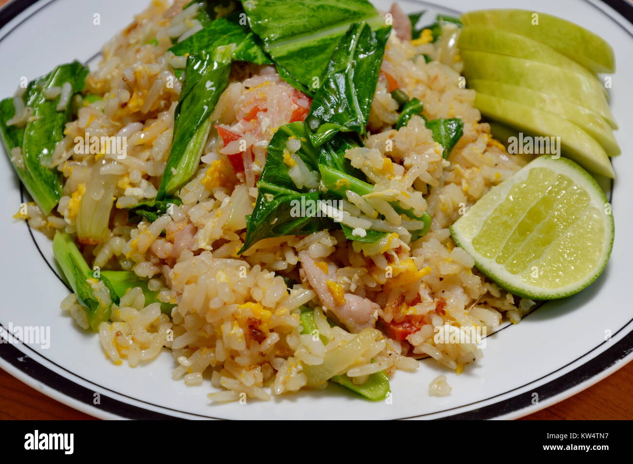 fried rice with Chinese kale and pork on plate Stock Photo