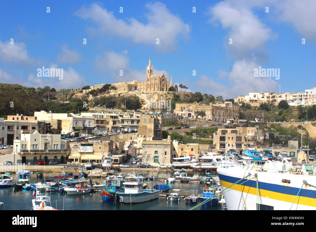 Mgarr, Gozo, Republic of Malta, with its port and the church on the hill - Stock Image