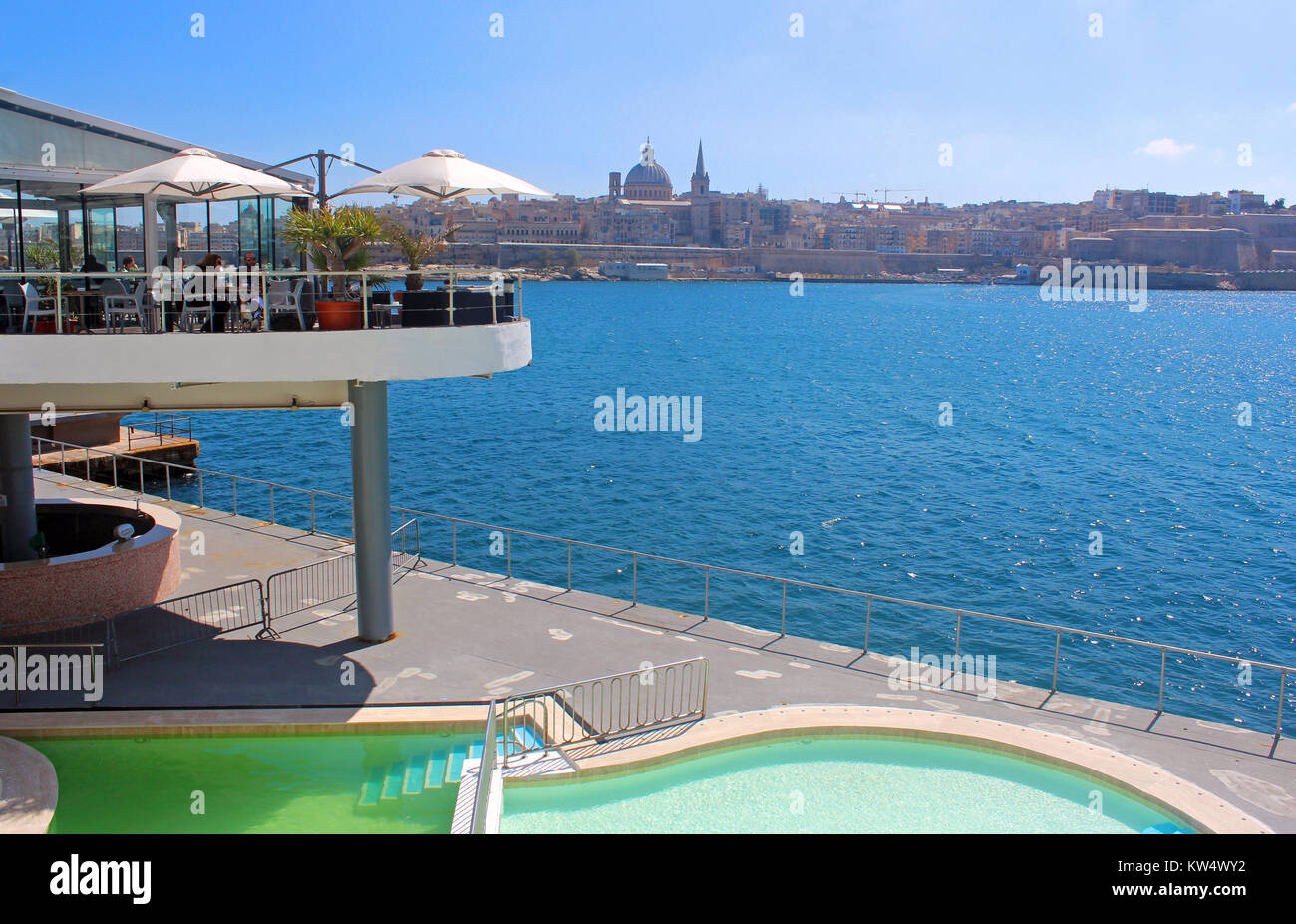 Valletta, Malta, view from Sliema, with swimming pool and roof terrace in the foreground - Stock Image