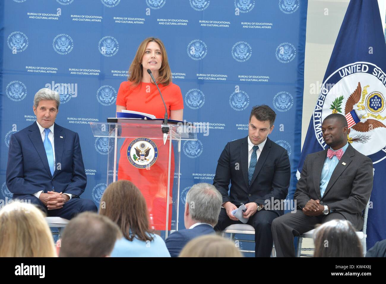 Assistant Secretary of State for the Bureau of Educational and Cultural Affairs Evan Ryan (at podium) speaks alongside U.S. Secretary of State John Kerry (far left) at the Airbnb luncheon for the U.S. Department of State's Gilman Scholarship Program, September 12, 2016. Image courtesy US Department of State. Stock Photo