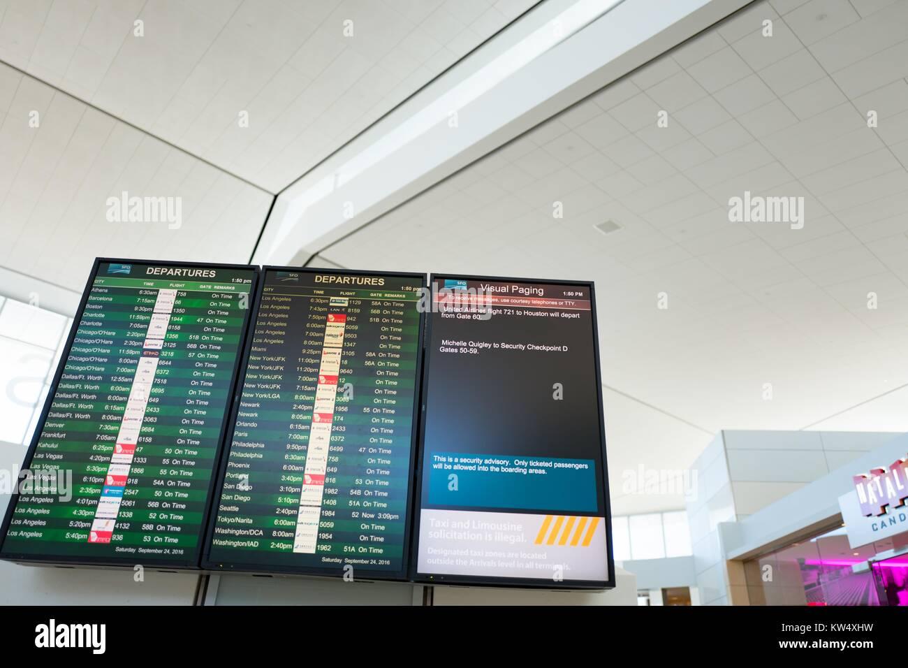 Departure board listing flight times at San Francisco International Airport, South San Francisco, California, New Stock Photo