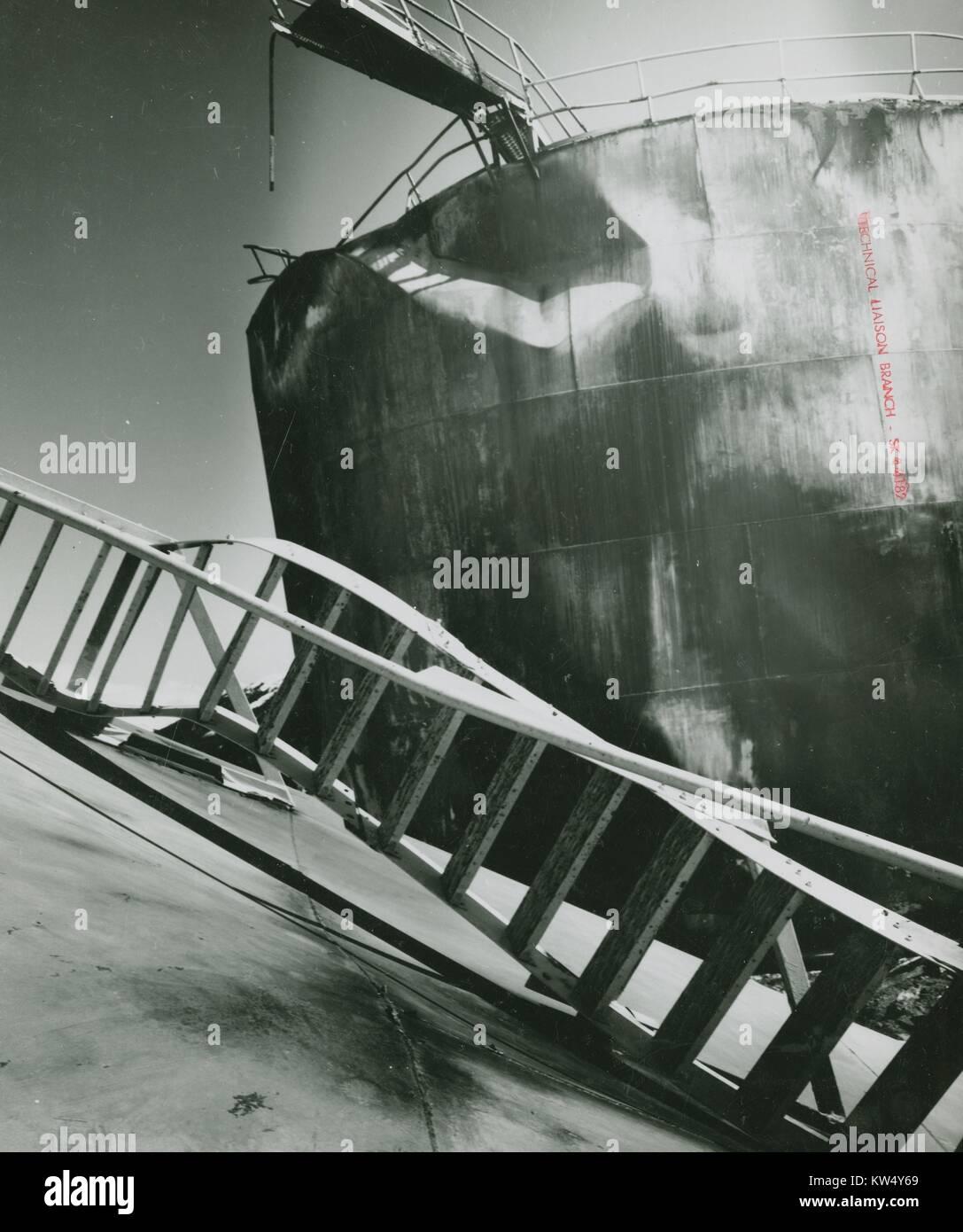 Damaged bulk tanks in Whittier, Alaska, 1964. - Stock Image