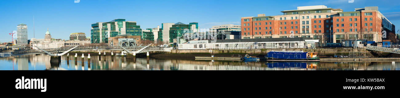 Dublin, Ireland, panoramic view over Liffey river with modern buildings and Sean O'Casey bridge in the back. Stock Photo