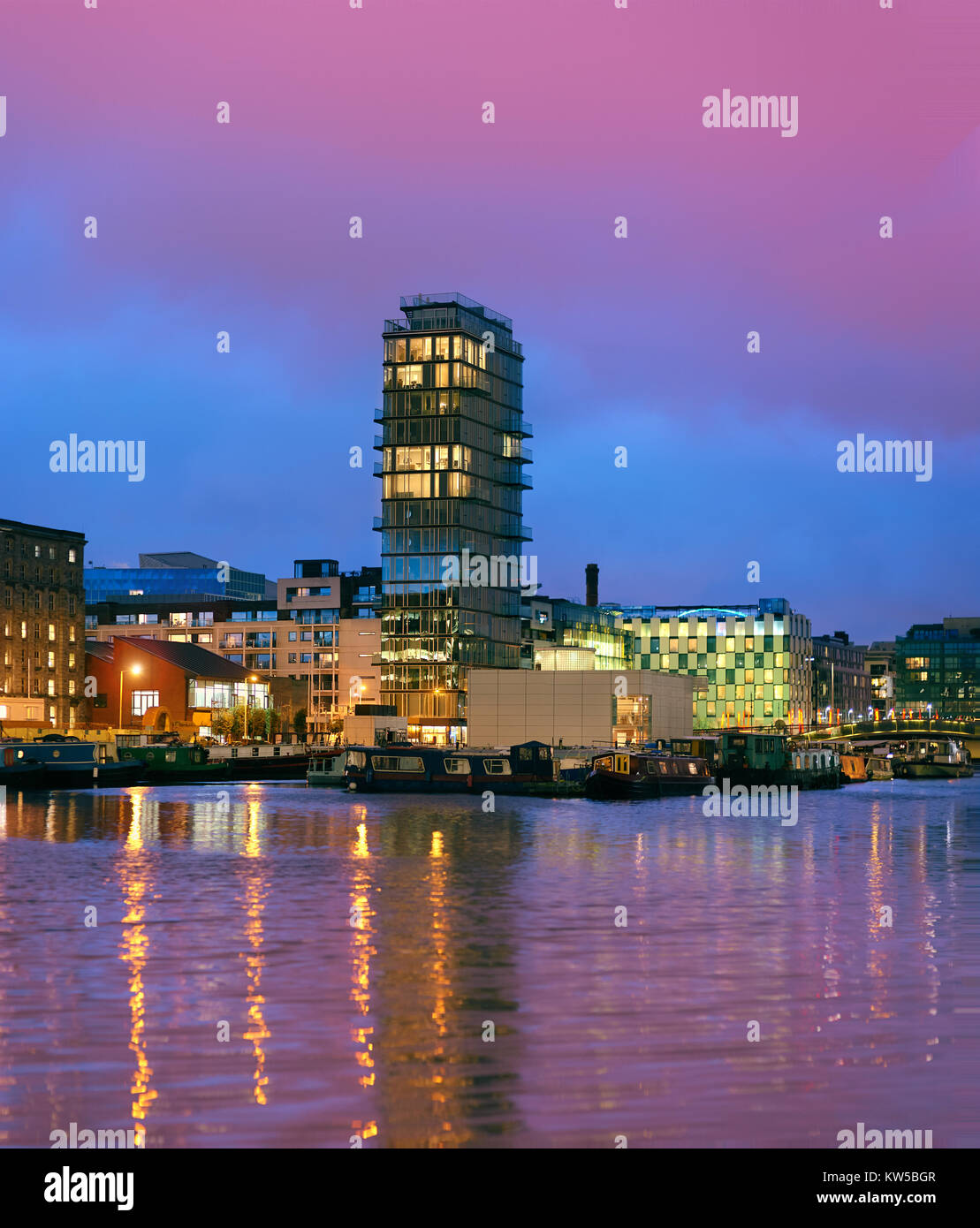 Modern part of Dublin Docklands, known as Silicon Docks on a sunset - Stock Image