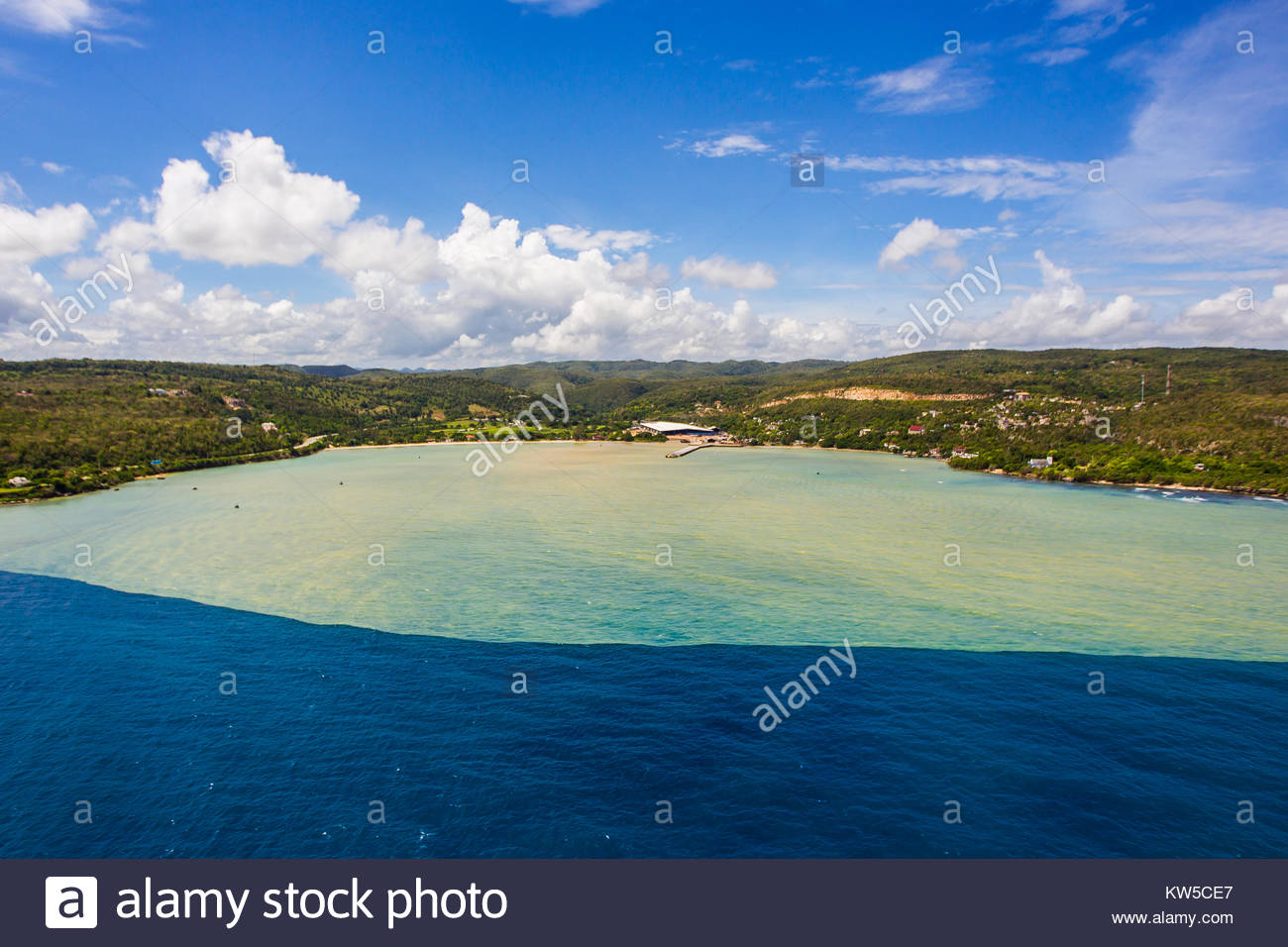 An aerial view of heavy rain runoff carrying soil, flowing into the Caribbean Sea on north coast of Jamaica. Stock Photo