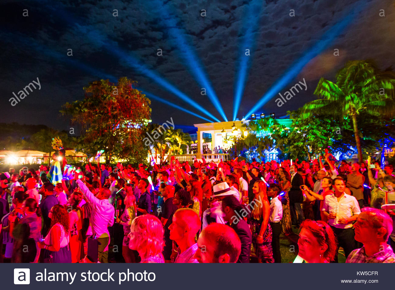 Laser lights shine into the sky during a concert at Sandals Resort in Ocho Rios. - Stock Image
