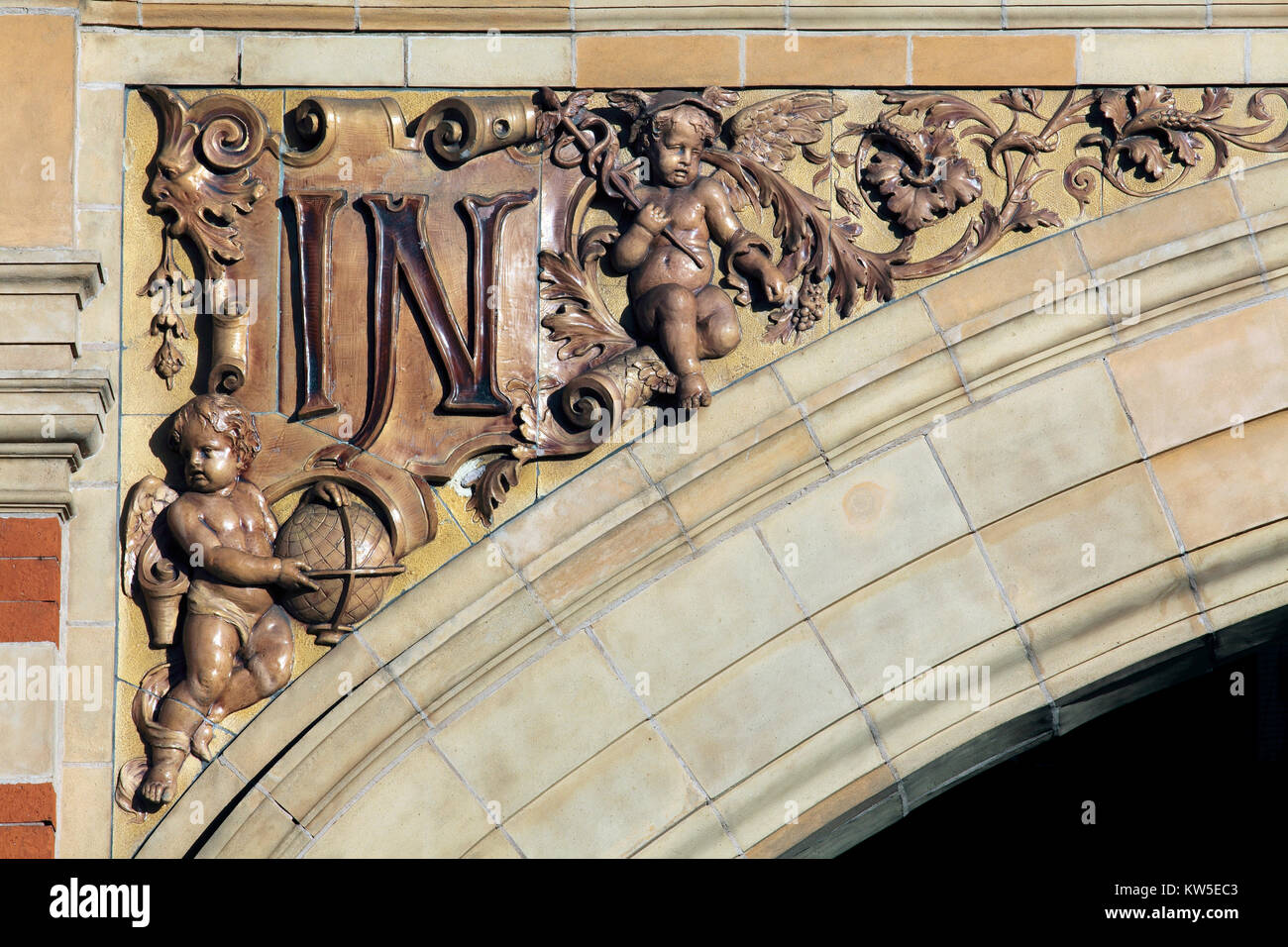 A close up of the flamboyant detailing on an archway spandrel on the London Road elevation of Leicester station. - Stock Image
