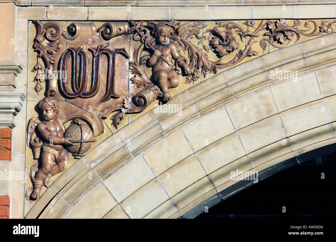 A close up of flamboyant detailing on an archway spandrel on the London Road elevation of Leicester station. 'Out' - Stock Image