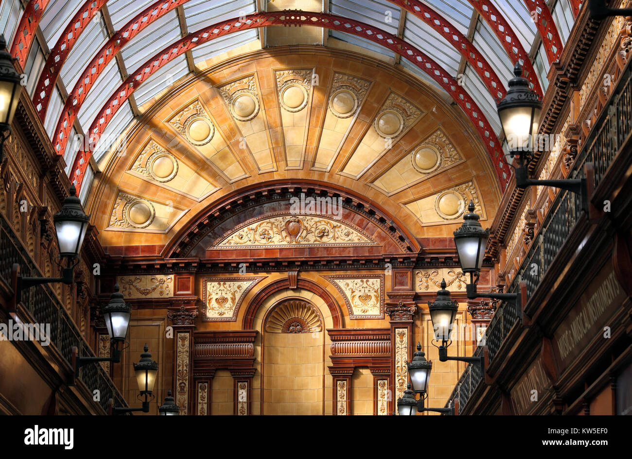 The sunlit Central Arcade, Newcastle Upon Tyne, showing the elaborately decorated end wall and the iron and glass - Stock Image