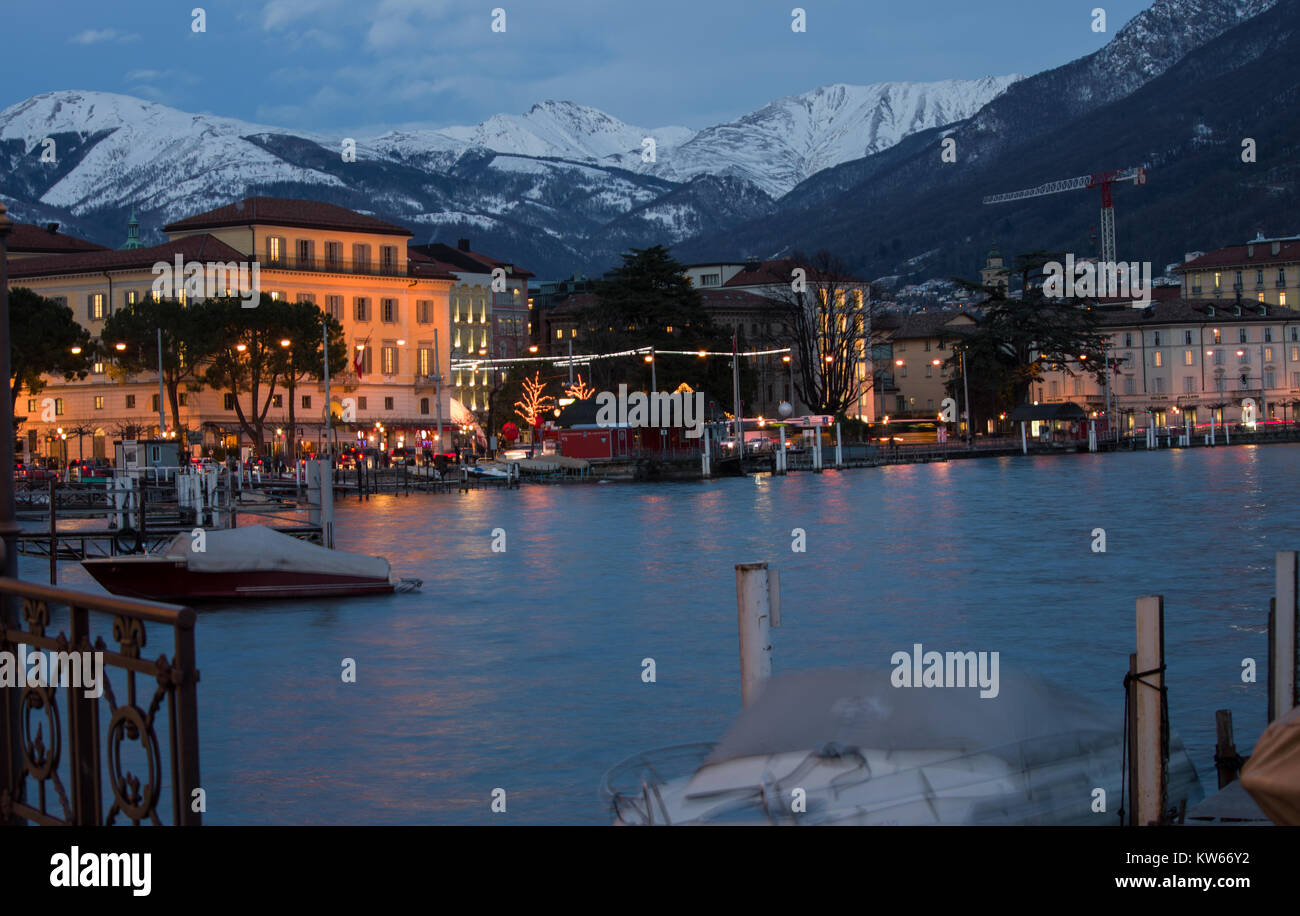 Lugano, Switzerland. a cold winter evening, with mountains covered in snow Stock Photo