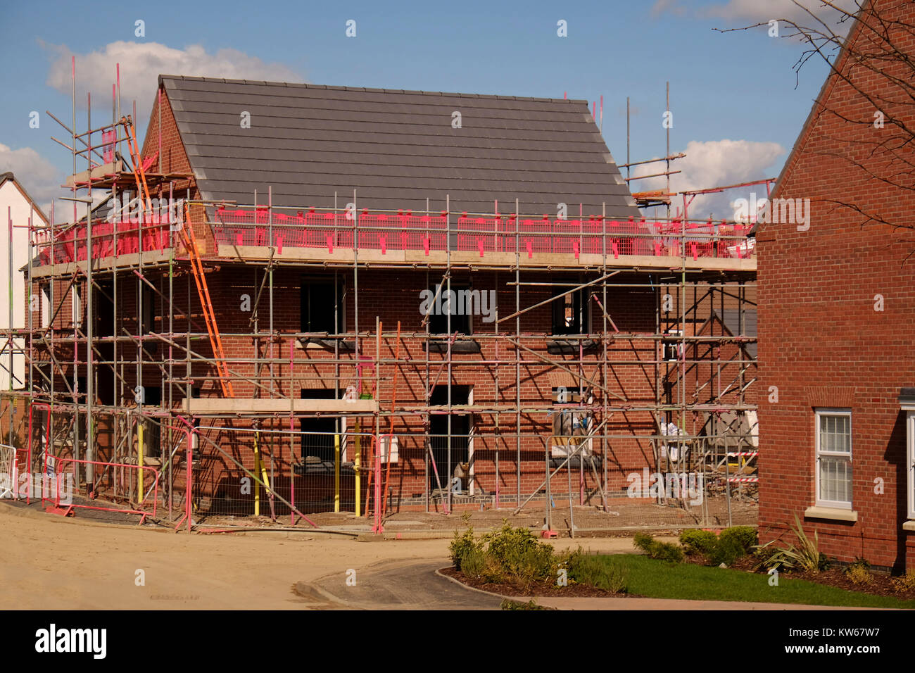 New house covered in scaffolding, Grantham, Lincolnshire, England, UK - Stock Image