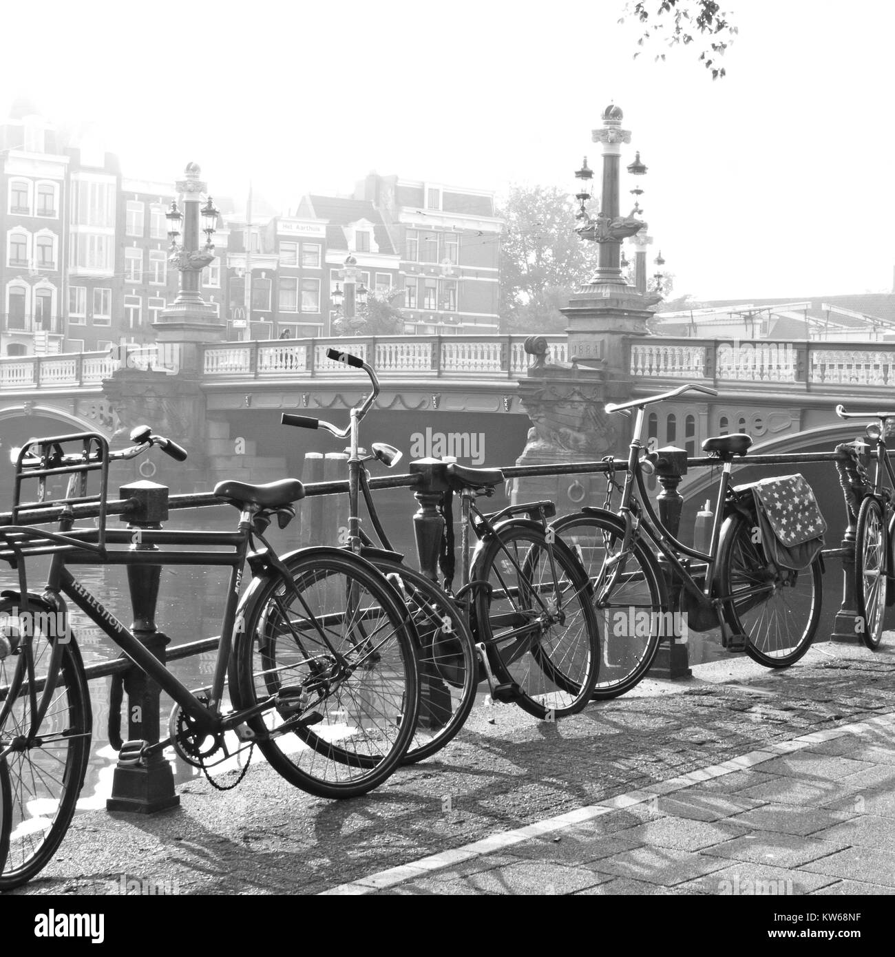 Old Amsterdam, bikes on bridge - Stock Image
