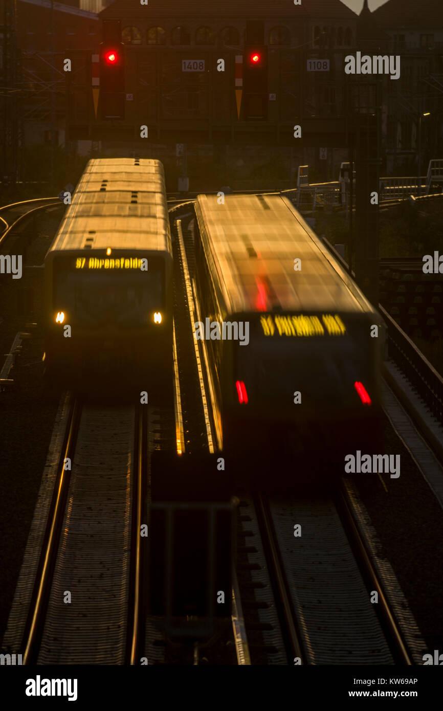 A S-Bahn train runs through the evening light to its destination, Berlin 2017. Stock Photo