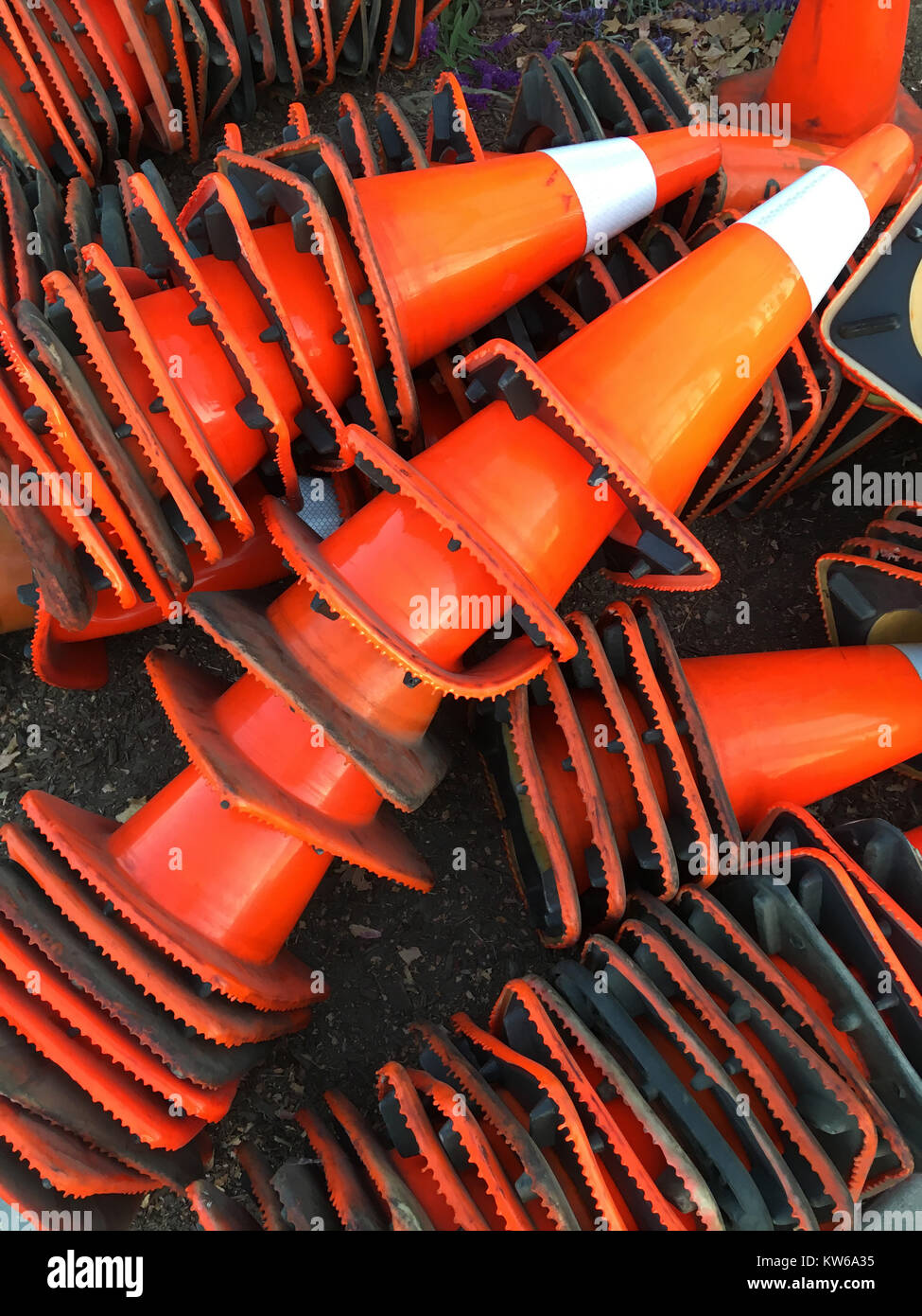 Stacked traffic cones - Stock Image