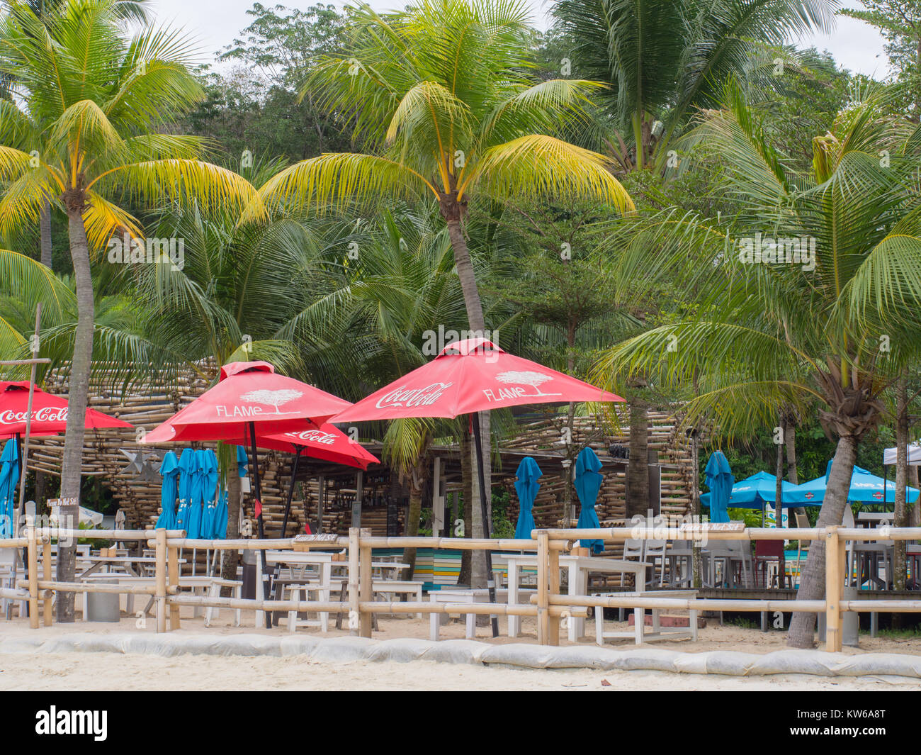 Beachside Tables And Umbrellas - Stock Image