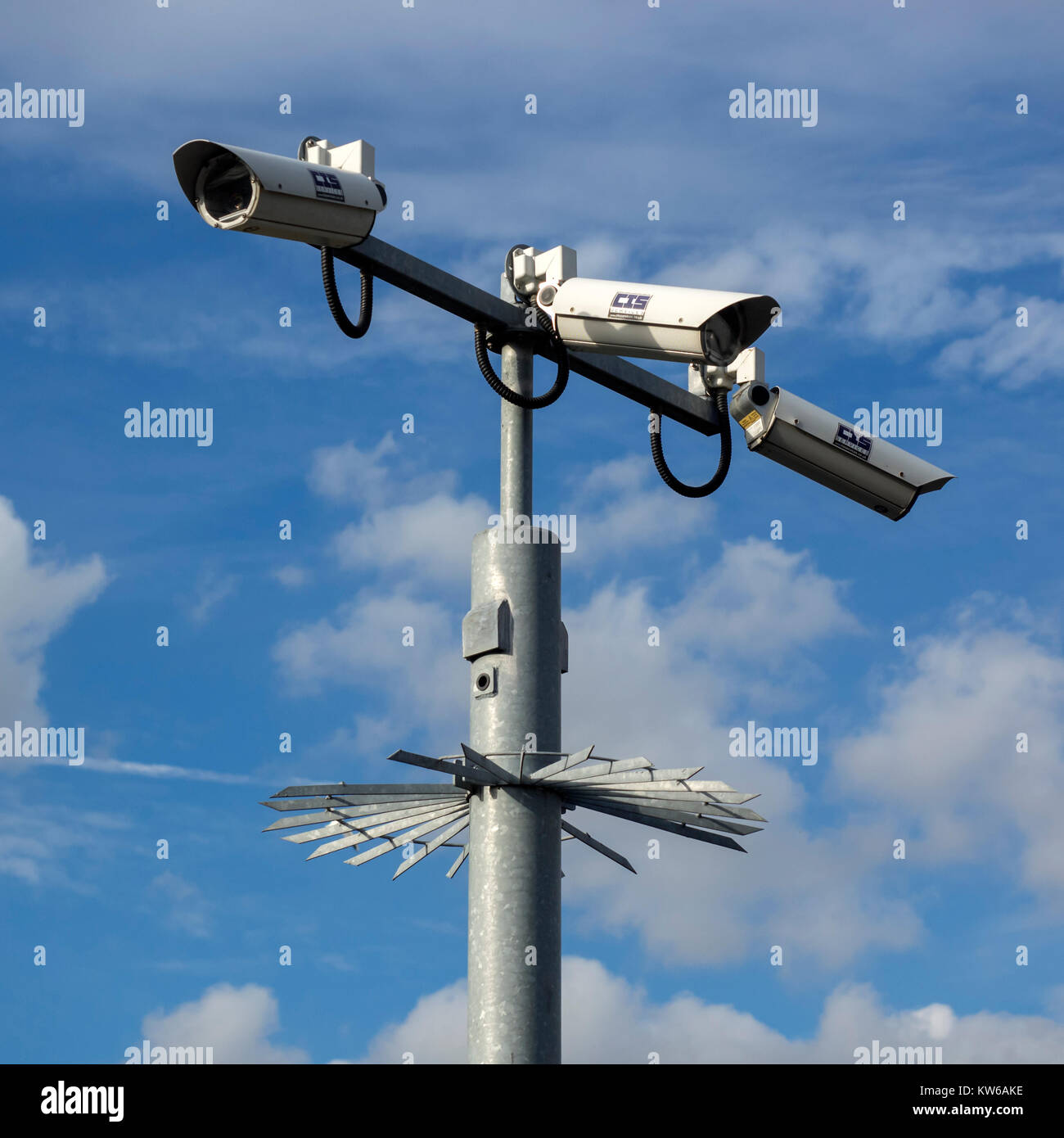 Closed Circuit Video Surveillance camera on pole  with anti-climb protection in the UK Stock Photo